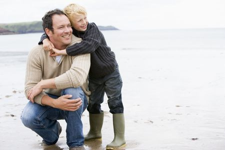 Father and son at beach smiling photo