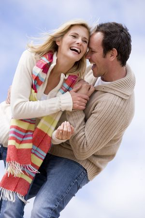 Couple standing outdoors smiling photo