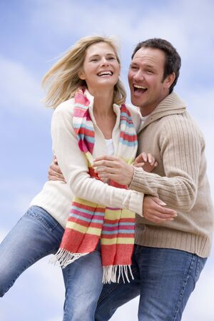 offset view: Couple standing outdoors smiling