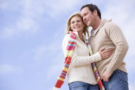 Couple standing outdoors smiling Stock Photo - 3599959