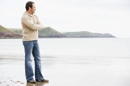 Man standing on beach Imagens