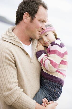 Father holding daughter at beach Stock Photo - 3600338