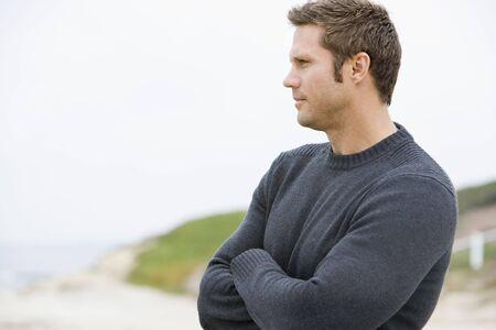 Man standing at beach Stock Photo