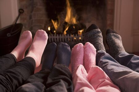 of Feet warming at a fireplace photo