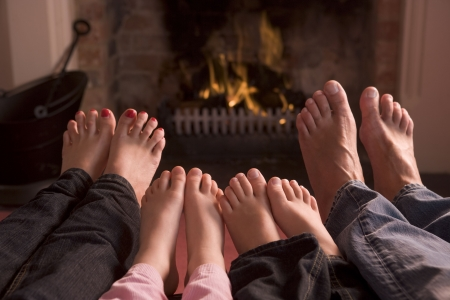 cosy:  of feet warming at a fireplace Stock Photo