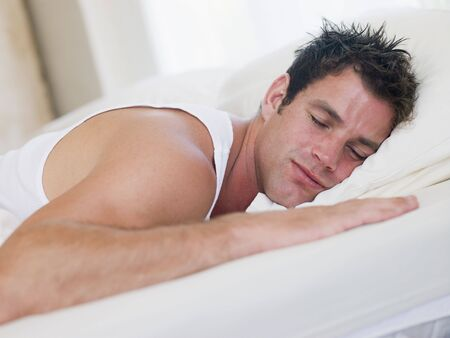man lying down: Man lying in bed sleeping