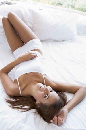 Woman lying in bed smiling Stock Photo - 3476389