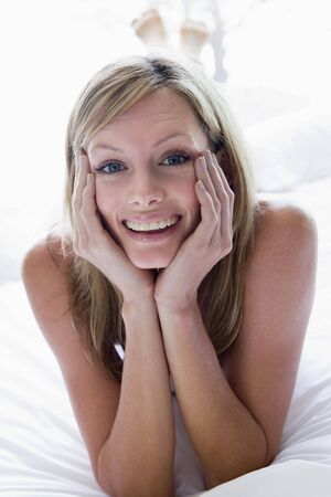 Woman lying in bed smiling Stock Photo - 3476464