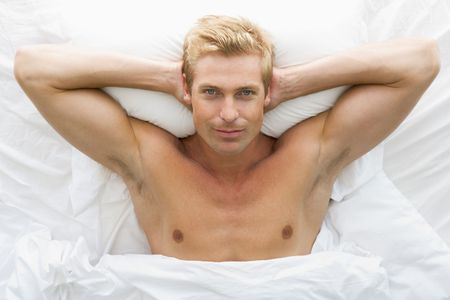 Man lying in bed relaxing photo