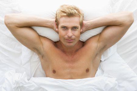 blonde underwear: Man lying in bed relaxing