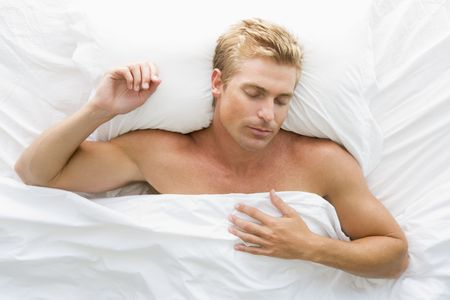 beautiful bed: Man lying in bed sleeping