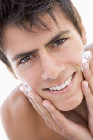Man putting on shaving cream smiling photo