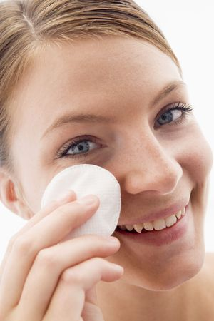 removing: Woman removing makeup and smiling