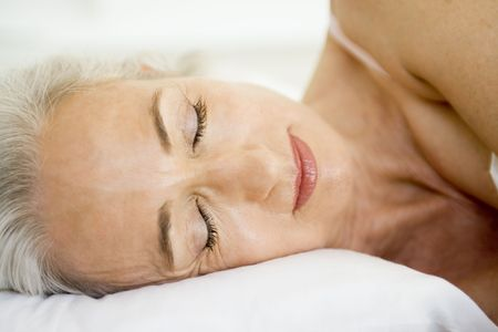 nightclothes: Woman lying in bed sleeping Stock Photo