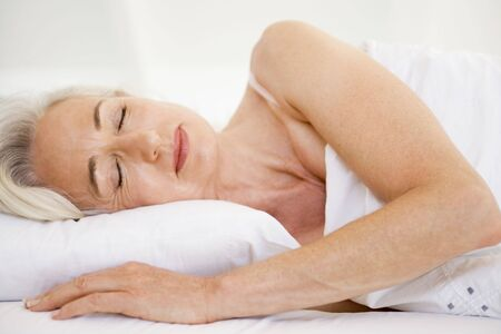 Woman lying in bed sleeping Stock Photo - 3477367