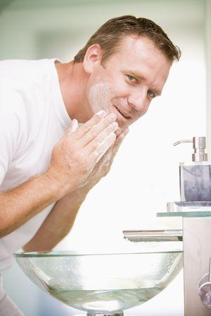 man in underwear: Man in bathroom washing face
