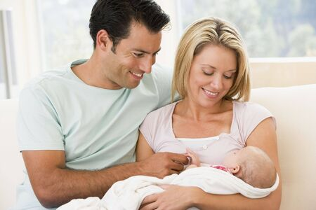 Couple in living room with baby smiling Stock Photo - 3470360