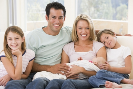 Family in living room with baby smiling Stock Photo - 3507103