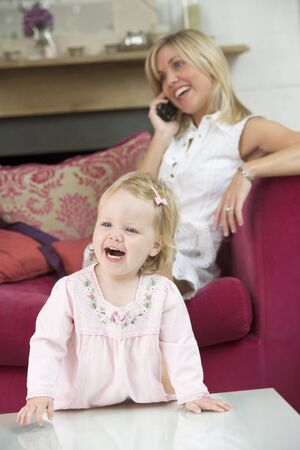 twenty four month old: Father and daughter indoors playing and smiling Stock Photo