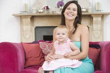 Mother in living room holding baby smiling Stock Photo - 3482275