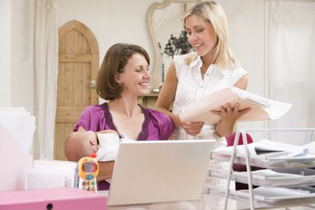 Two women and a baby in home office with laptop Stock Photo - 3506650