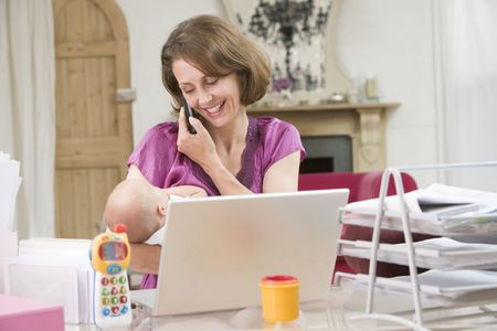 Mother and baby in home office with laptop and telephone Stock Photo - 3506667