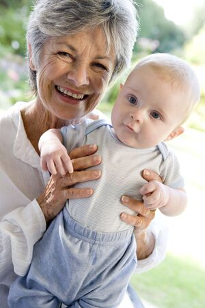 Grandmother outdoors on patio with baby smiling Stock Photo - 3603661