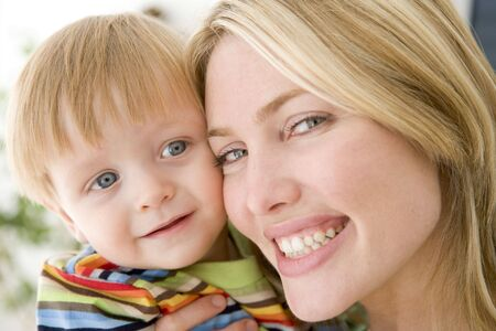 twenty four month old: Mother and young boy indoors smiling Stock Photo