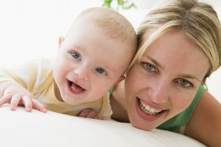 Mother and baby indoors smiling photo