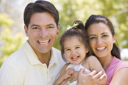 hispanic girls: Family standing outdoors smiling Stock Photo