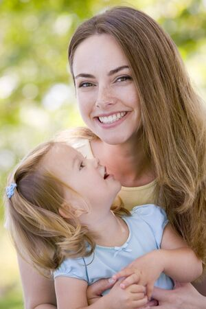 Mother holding daughter outdoors smiling Stock Photo - 3507196
