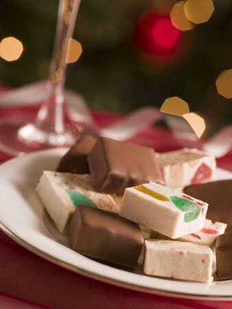 Plate of Chocolate Dipped and Plain Nougat Stock Photo - 3603028