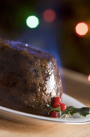 christmas pudding: Christmas Pudding with a Brandy Flamb  Stock Photo