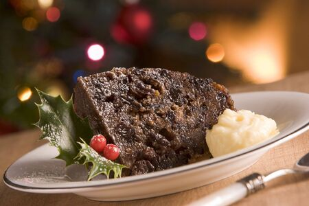 christmas pudding: Portion of Christmas Pudding with Brandy Butter