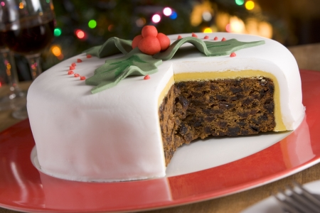 fondant: Decorated Christmas Fruit Cake with slices taken