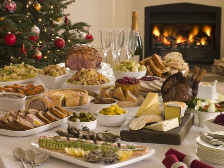 christmas cooking: Boxing Day Buffet Lunch Christmas Tree and Log Fire Stock Photo
