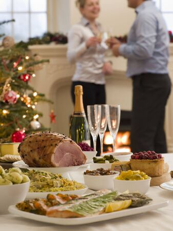 boxing day: Boxing Day Buffet Lunch Christmas Tree and Log Fire Stock Photo