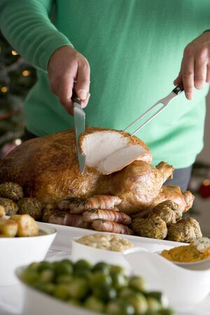 Carving Christmas Roast Turkey with all the Trimmings Stock Photo - 3602709