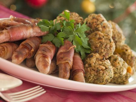 stuffing: Plate of Pigs in Blankets and Chestnut Stuffing Balls