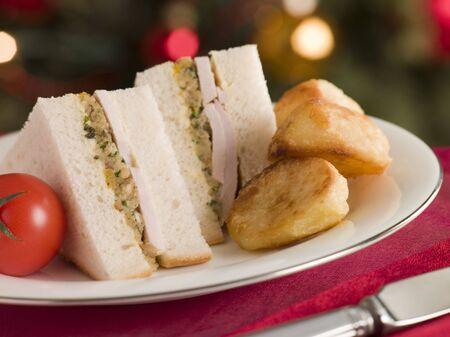overs: Roast Turkey Stuffing and Mayonnaise Sandwich with Cold Roast Potatoes Stock Photo