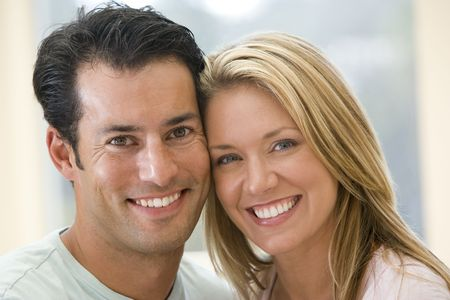 30s: Couple indoors smiling