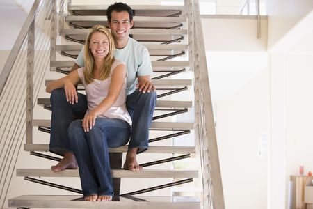 Couple sitting on staircase smiling Stock Photo - 3601464