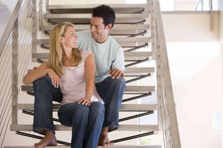 Couple sitting on staircase smiling photo
