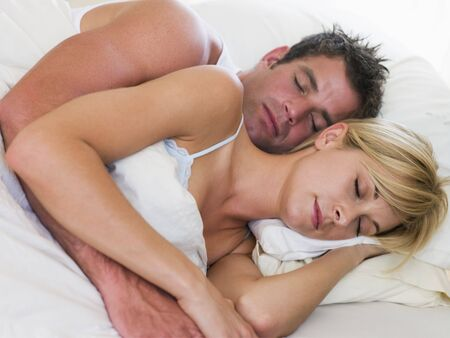 affectionate: Couple lying in bed sleeping Stock Photo