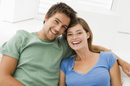 Couple in living room smiling photo