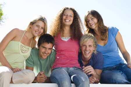 Five people on balcony smiling Stock Photo - 3603455