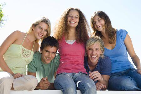 Five people on balcony smiling Stock Photo - 3603455