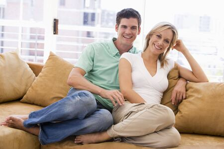 Couple in living room smiling Stock Photo - 3602726