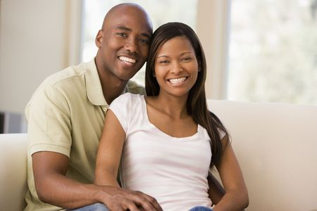 30s thirties: Couple in living room smiling