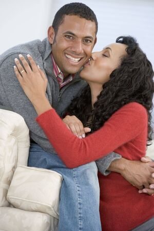 Couple in living room kissing and smiling Stock Photo - 3603343